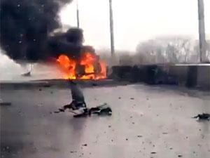 Чергові жертви донецького пекла: на мосту загинули дві людини (фото, відео 18)