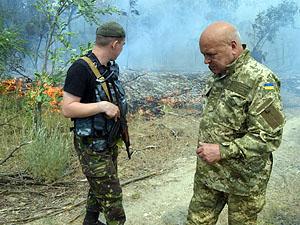 Після обстрілу в районі Трьохізбенки горить сосновий ліс (фото)