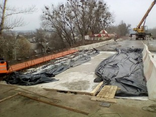 Ремонт пошкодженого моста: Роботи виконуються згідно встановленого графіку (ФОТО)