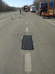 Як ремонтують Окружну дорогу навколо Харкова (ФОТО)