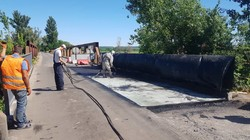 Під Харковом ремонтують аварійний міст (ФОТО)